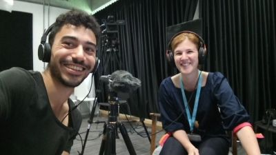 Two scientists recording a podcast